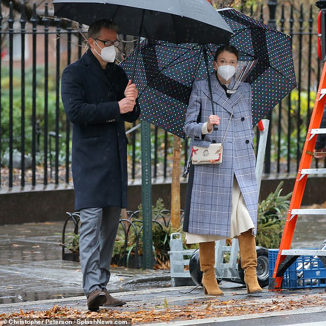 Sutton Foster is chic in plaid trench coat on rainy New York City set of Younger with Peter Hermann