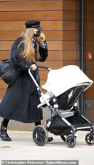 Model behavior: Gigi showed her supreme fashion sense by wearing a black jacket that draped over her knees