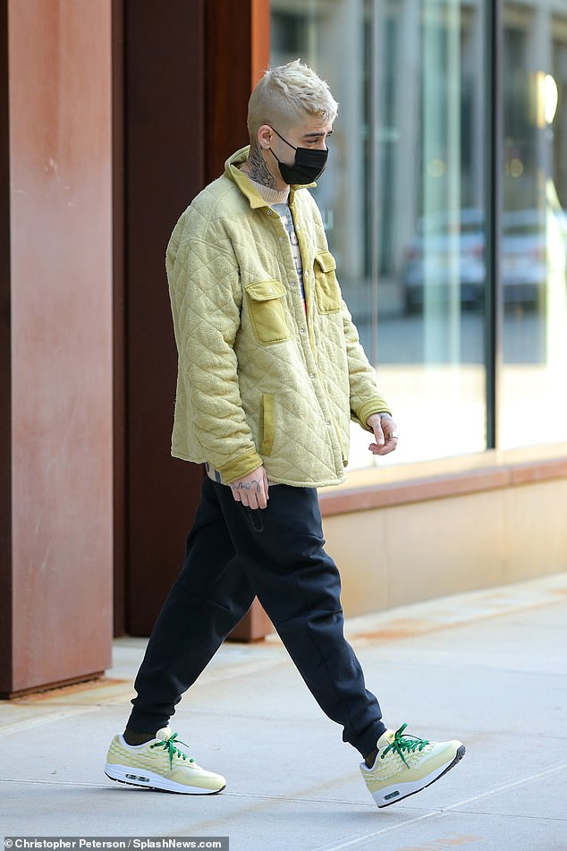 Daddy's obligation: Zayn was also spotted in the Big Apple for the first time since giving birth to his little one as he stepped out wearing a yellow jacket to match his shoes