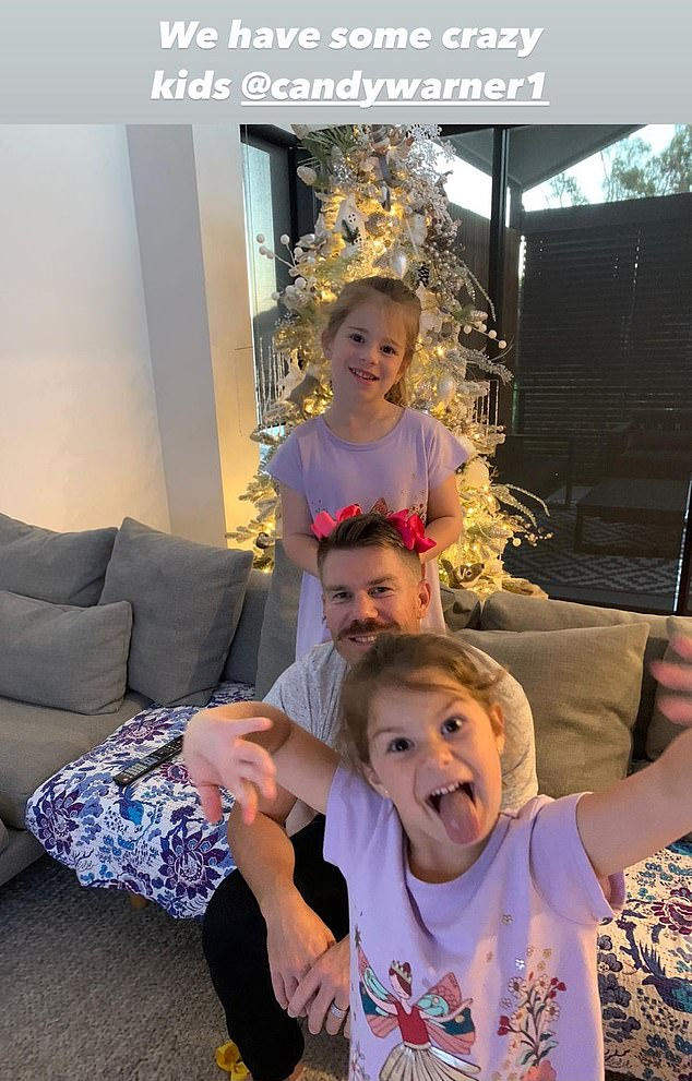 Nice tree! Taking to Instagram on Wednesday, David shared a glimpse at what Christmas will look like in the Warner household. He is pictured here with his two eldest children