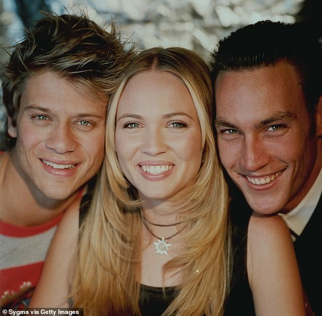 Comeback: Speaking to New Idea on Wednesday, the youthful 42-year-old said she wouldn't be opposed to returning to the fictional Hartley High for the upcoming Netflix reboot.Pictured (L-R): Heartbreak High stars Rel Hunt, Lara Cox and Callan Francis Mulvey circa 1999