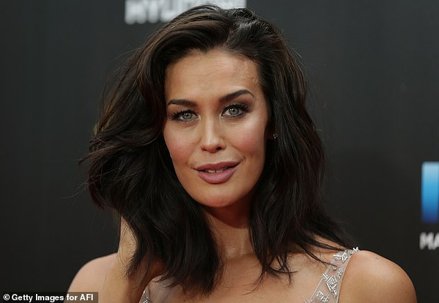 Stunner: Megan Gale (pictured), 45, recently debuted her incredible post-lockdown makeover. And on Wednesday, she flaunted a stunning dress which she wore while filming her 'last day of work for the year' on Australia's Best House.