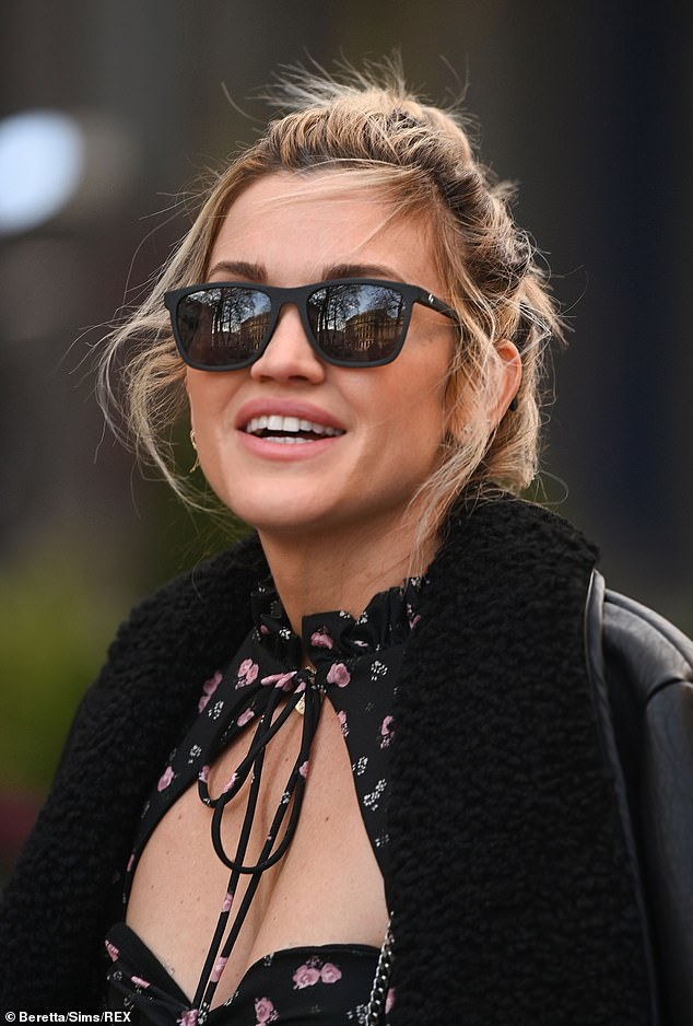 So glamorous: Ashley looked fabulous as she strutted out of Global studios following her radio duties
