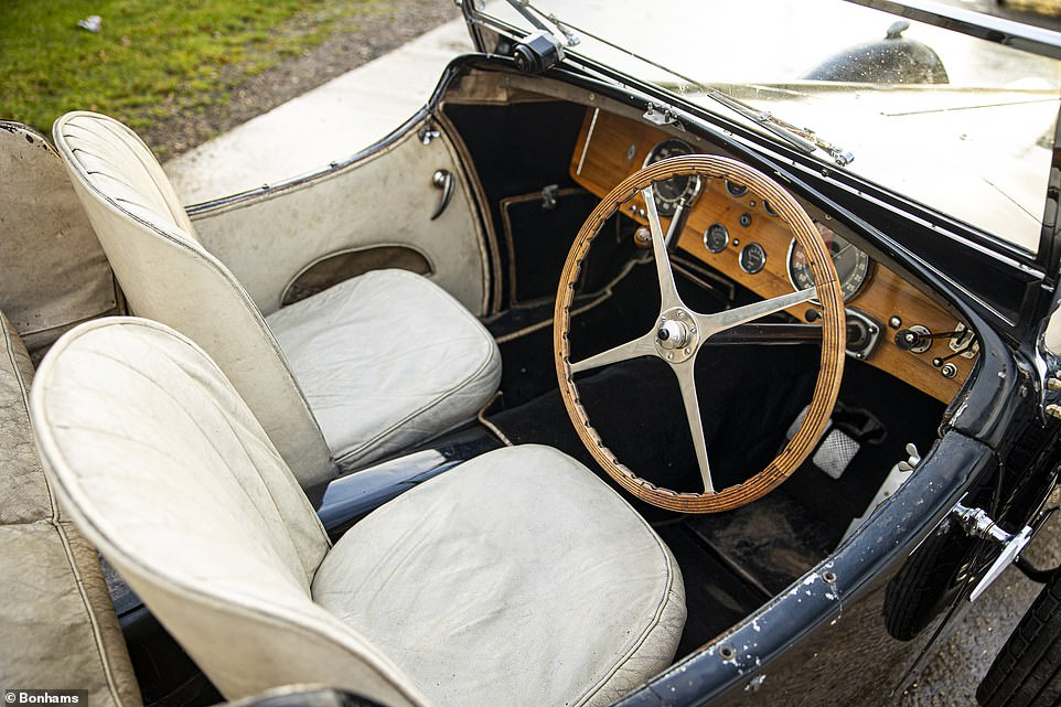 It is offered to the highest bidder with 'almost perfect' black paintwork, cream leather interior and original coachwork