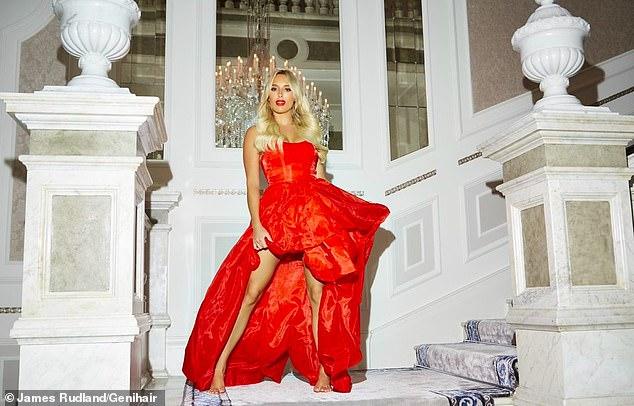 Chic: In one of the stunning shots for the campaign, TOWIE star Amber, 27, took centre stage as she exuded glamour in a red puffball gown while showcasing her voluminous tresses