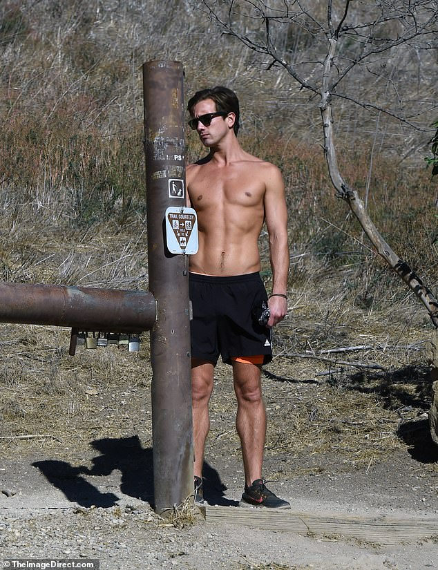 Buff bod: Busch put his gym-honed physique on display as he basked in the sunshine