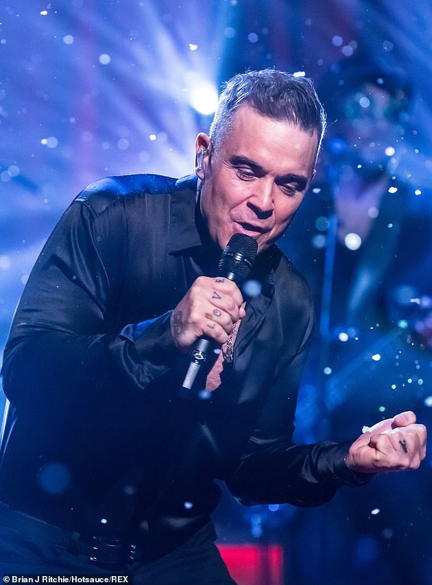 Personas: Speaking in more detail about his family life, Robbie also revealed he has a different personality when performing compared to what he was at home (pictured last week)