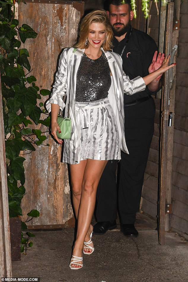 Styling: Dressed in a shimmery high-waist short suit, the blonde bombshell's taut pins were on show as she waved to the cameras and made her way into meet and greet fans