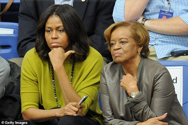 """'If we say defund the police, not just white folks, but Michelle's mom might say, """"if I'm getting robbed who am I going to call?:' he said of his mother-in-law Marian Robinson, pictured above with Michelle Obama in 2014"""
