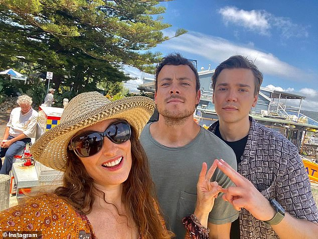 Farewell: The Home and Away cast filmed their final scenes for the year in Palm Beach on Wednesday, just one day before a Covid-19 outbreak on Sydney's northern beaches. Pictured (L-R): Georgie Parker,Patrick O'Connor andLukas Radovich