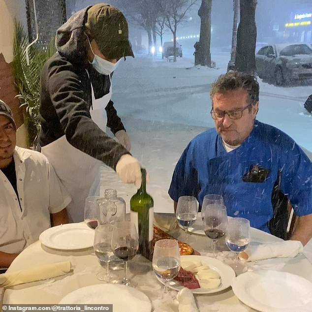 NYC restaurant owner mocks Gov. Cuomo's ban on indoor dining by hosting dinner for staff in the SNOW