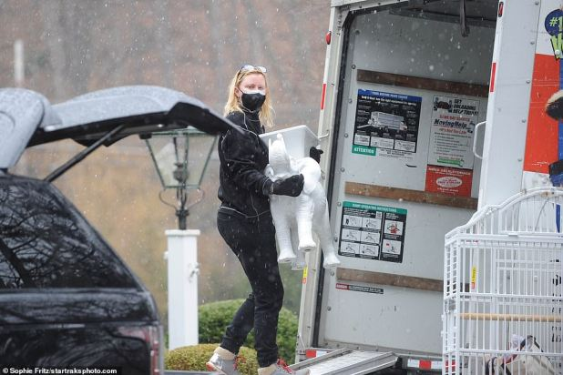 On Monday, Lee was seen removing the last pieces of furniture outside the house and into a moving truck.