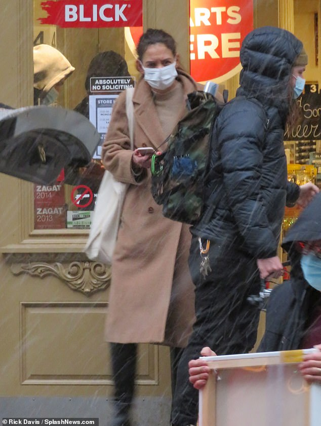 Winter essentials: The 5ft9in Batman Begins actress wore a set of dark pants and knee-length black snow boots to help stay dry