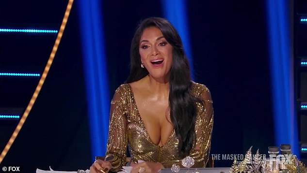 Good guess: Nicole correctly guessed that Sun was LeAnn as she showed off her gold look on the panel