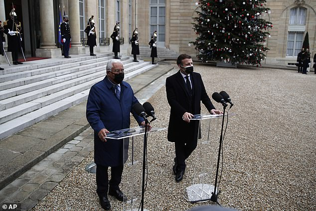 WEDNESDAY:Macron, right, and Portuguese Prime Minister Antonio Costa answer reporters