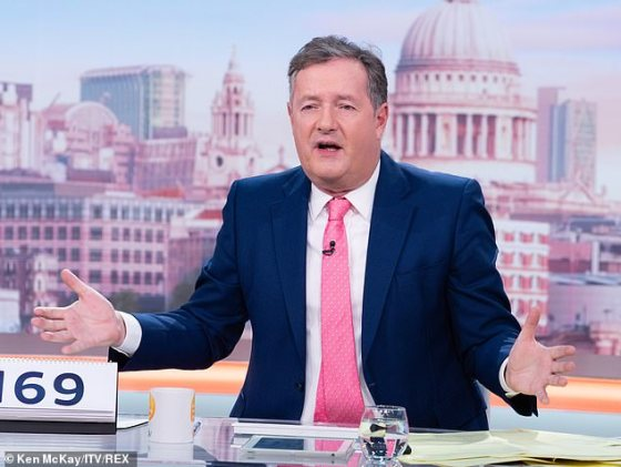What a gift: On Instagram, GMB host Piers, 55, shared a photo of himself holding up the mug that read 'W **** r', writing, 'If you mistakenly think your colleagues are like it'