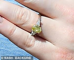 Pictured: Laura showed off her flashy diamond engagement back in April, but Iain is thought to have proposed earlier this year