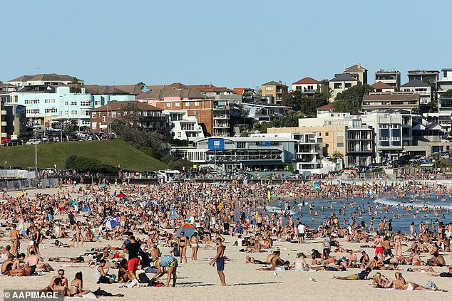 Like March, a wealthy part of the harbour city is the epicentre of a coronavirus scare. Pictured is a crowd at Bondi Beach on March 20, the day Australia's border was closed to non-residents and non-citizens