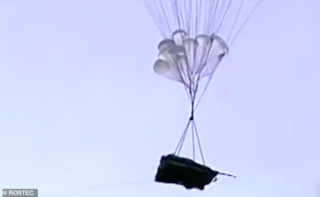Dropping in: Russia's amphibious Sprut-SDM1 tank is parachuted to the ground in a promotional video, with manufacturers saying it can carry three crew while doing so