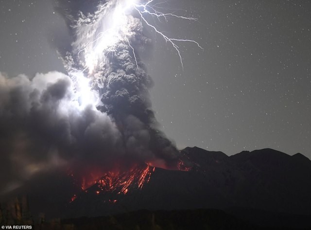 Fire and fury: Lightning bolts above Sakurajima, an active volcano on Japan's Kyushu island, which erupted this week with plumes of ash rising a more than a mile above the mountain and blending with clouds in the night sky