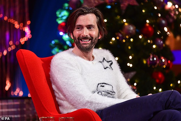 Festive: David looked festive for his appearance on the show, donning a white fluffy sweater