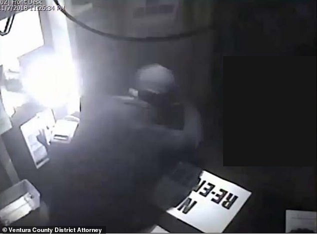 At one point, grainy footage shows Long from behind leaning over a counter at the bar's entrance and shooting at the officers