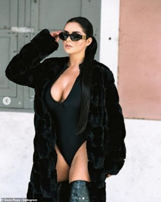 Demi Rose dons a plunging black swimsuit before slipping her curves into a busty checked number