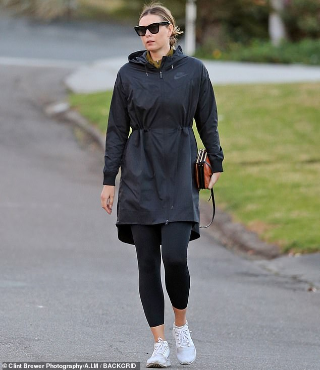 When you got it:The 33-year-old former tennis star was sleek and chic in a fitted black raincoat and leggings that emphasized her still athletic figure