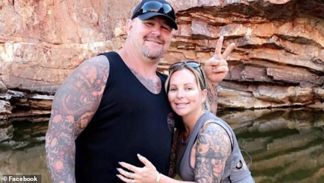 Former Rebels boss Nick Martin (pictured with his wife) was shot in the back at the Outlaw Nitro Challenge drag racing event at the Perth Motorplex at 8.30pm on 12 December