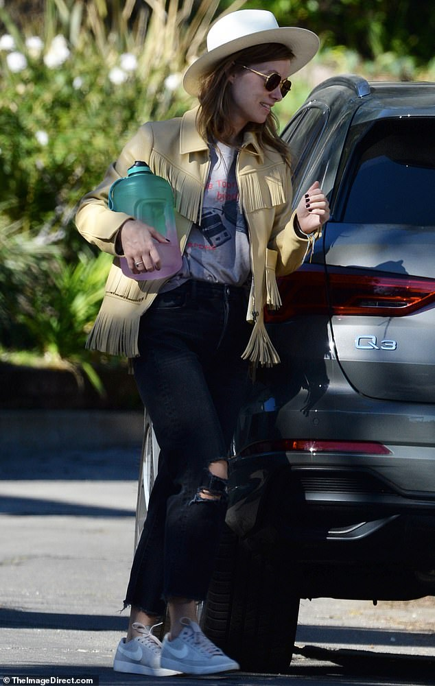 Leather queen: The 36-year-old kept with a cowboy theme for an apparent birthday party outing, sporting a yellow leather jacket trimmed in fringe