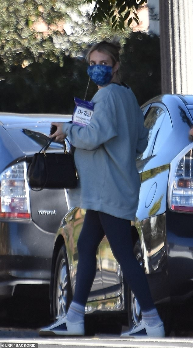 Emma Roberts covers up her baby bump during an errand run … as she awaits birth of her first child