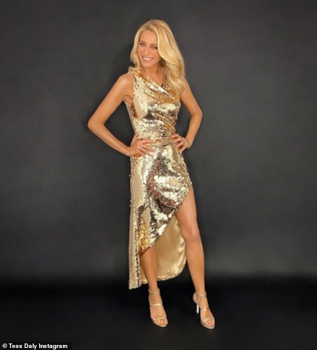 Wow: Tess Daly looked sensational for the 2020 Strictly Come Dancing finale on Saturday night as she marveled in a dazzling gold sequin midi dress with a daring thigh slit