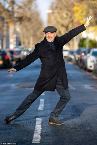 Strictly champion Bill Bailey jubilantly dances outside his home after reuniting with wife Kristin