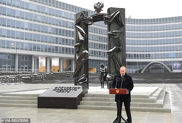 Putin braved frigid temperatures to give his speech outside the SVR's headquarters.'I wish success to everyone who defends Russia, our people from external and internal threats, defends sovereignty and national interests,' he said