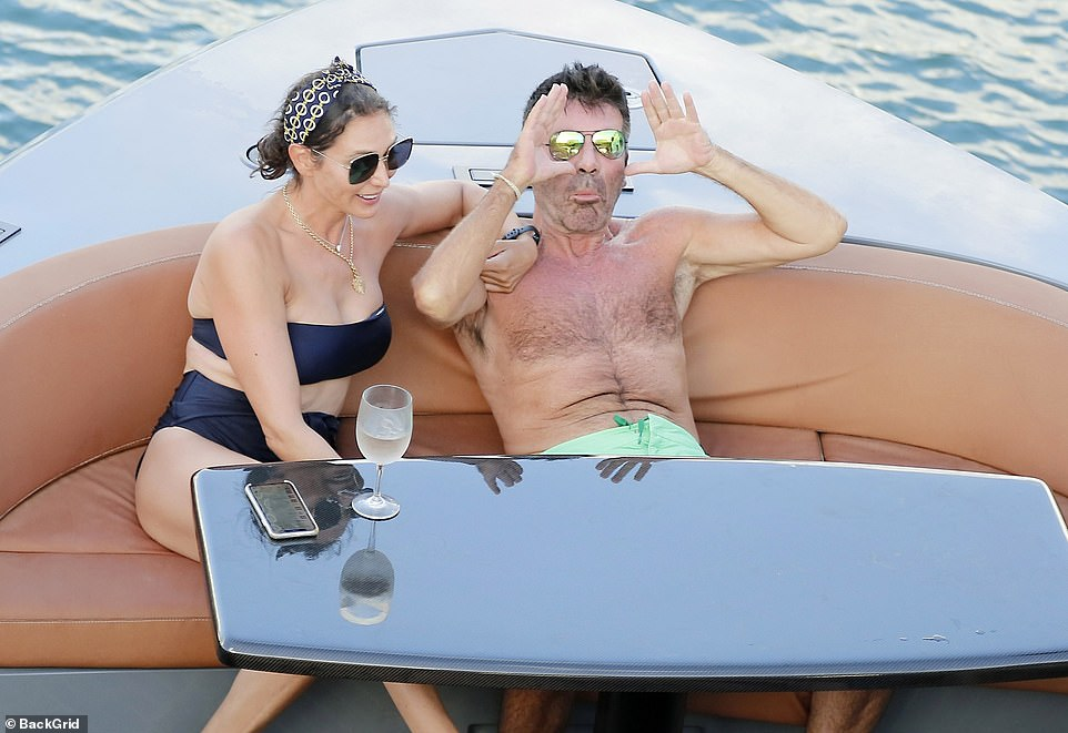 Carefree!Simon Cowell enjoyed a lavish boat trip and jet ski ride with his partner Lauren Silverman and son Eric, six, in Barbados on Saturday