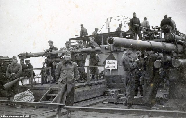 Crew smile and stand around the 88mm guns onboard one of the landing crafts.The black and white images show the fleet of armoured landing craft Adolf Hitler had made in readiness for a seaborne invasion in 1940