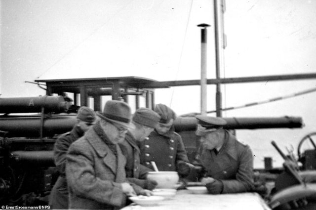 Meal time aboard one of the landing crafts wherethe Germans were preparing to invade Britain during the Second World War in 1940