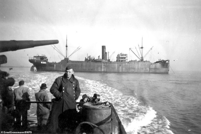 A landing craft passing a ship at anchor.Chilling photographs show the Germans preparing to invade Britain during WW2 in 1940
