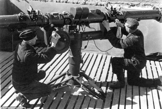 German crew cleaning hardware onboard one of the landing crafts.The black and white images highlight the fleet of armoured landing craft