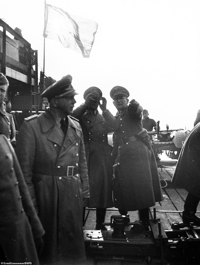 Chilling photographs showing the Germans preparing to invade Britain during the Second World War have emerged for the first time. Pictured: Officers watching the sea trials