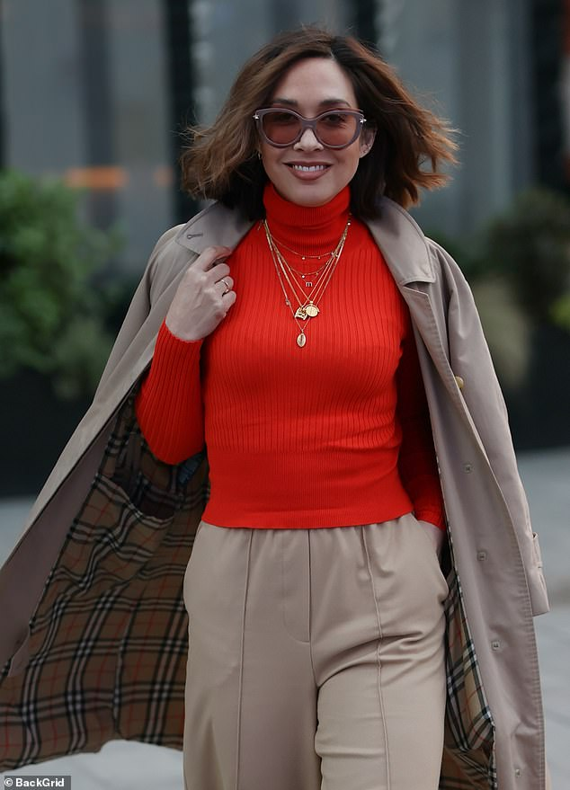 Style:Her brunette tresses were styled in soft waves while she accessorised with a pair of chic shades