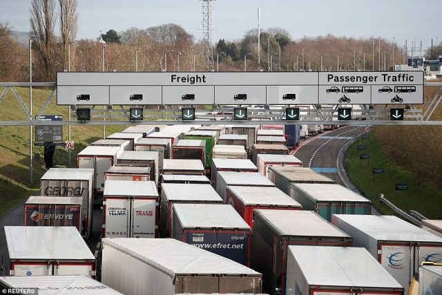The Port of Dover closed to all accompanied traffic leaving the UK for the next 48 hours after France imposed an inbound travel ban. Pictured: Lorries queue on the M20 in Folkestone