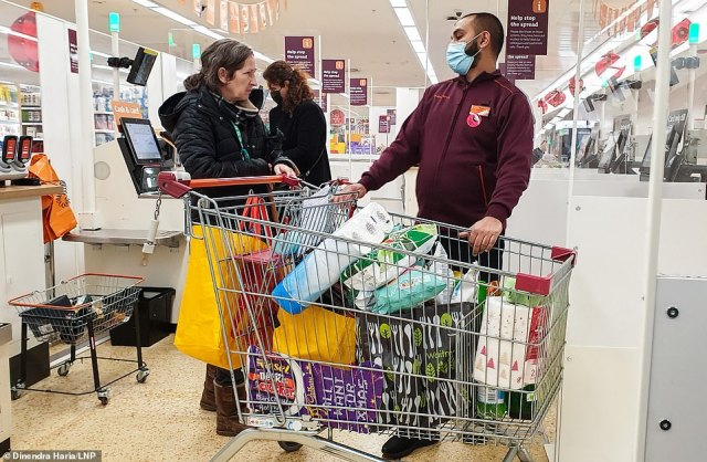There was a rush of shoppers pre-8am this morning at this Sainsbury's store in north London with packed trollies seen at the tills