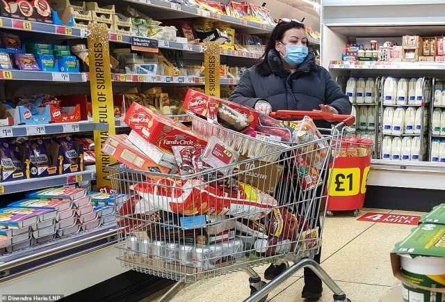 Shoppers in Sainsbury's supermarket in north London before 8am, buying festive groceries, just four days before Christmas day amid a French ban on British hauliers