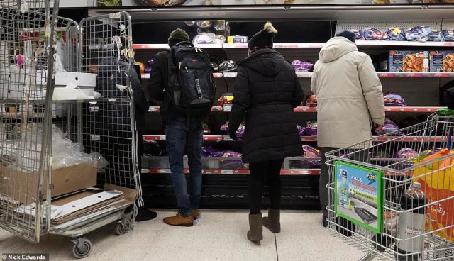 Shoppers were seen picking up turkeys for their Christmas dinner at this Asda store in London on Old Kent Road