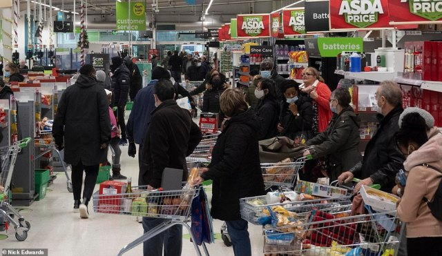 The Asda store on London's Old Kent Road was also busy today as shoppers queued for the tills to pay for their shopping