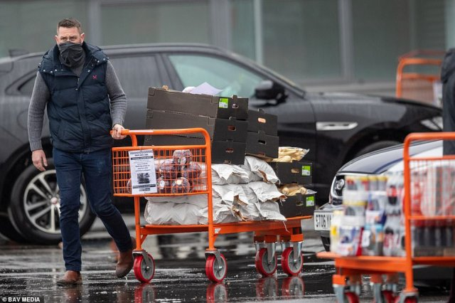 People were seen stocking up on parsnips at Tesco Cash and Carry in Cambridge on Monday morning as the supermarkets told customers not to panic buy