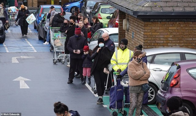 Long queues outside Asda at Clapham Junction in South West London today, with just four days to go until Christmas