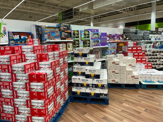 Non-essential toys and video games were blocked off by cases of beer at the Asda store in Cardiff following the Welsh government lockdown announcement