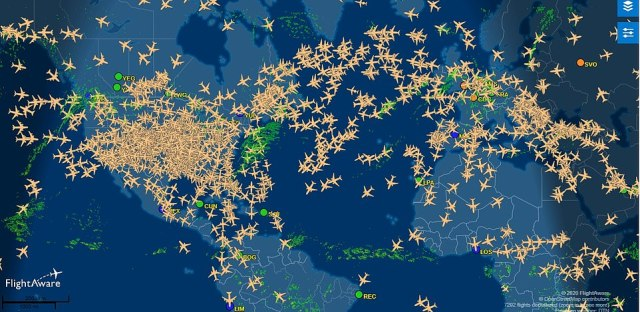 A global air traffic map shows dozens of flights over the Atlantic on Monday including many from London to JFK while more countries cut the UK off over the new strain of COVID-19